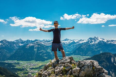 Man celebrating nature and reaching the summit in the Alps, Germany Stock Photo