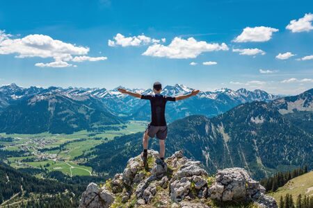 Hiker Enjoying the View from Mountain Valley Trail, Alps, Austria.