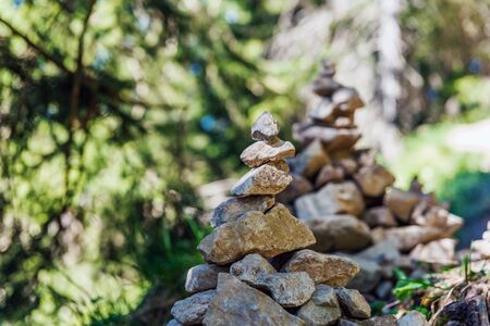 longevity: Stacks of rocks or pebbles, part of the popular trend of stacking, in nature symbolic of longevity, luck and happiness but thought by conservationists to disturb the habitat and increase erosion