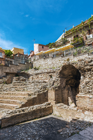 Ruins of the Roman Odeon Theatre, Taormina, Sicily a small building of clay bricks used for music and performances with a seating capacity of around 200 people