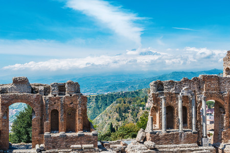 Greek theater in Taormina with the smoking Mount Etna Volcano in the back in Sicily, Italy Stock Photo