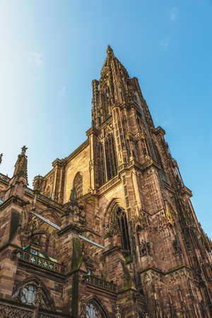 unesco: Exterior facade of the Cathedral in Strasbourg, France showing the Romanesque style architecture built during the Middle Ages and the sixth tallest church in the world viewed from below looking up Stock Photo