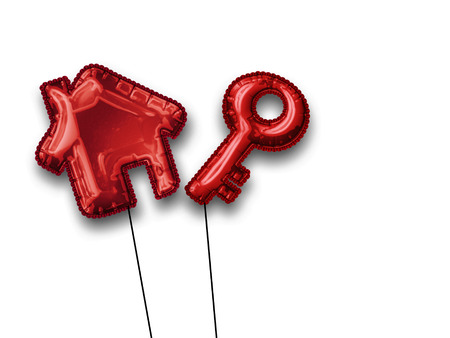 Two floating metallic red house and key shaped balloons isolated on a white background with copy space.