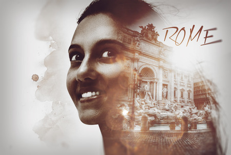 Fine art multiple exposure of an attractive friendly female tourist in Rome with her smiling face overlaid with the Trevi Fountains in vintage sepia tones with copy space for a poster or card