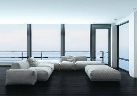 Sofa in spacious bright lounge room with large windows
