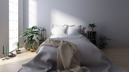 bedroom design: Double bed with blanket in bright minimalist bedroom among houseplants Stock Photo