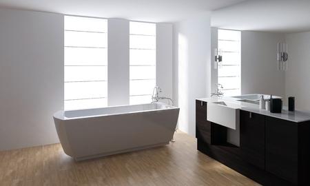 White porcelain bathtub and washstand with mirror in minimalist clean bathroom