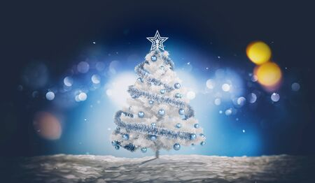 Traditional seasonal card with a white Christmas tree decorated with blue baubles and tinsel outdoors at night against blurred lights