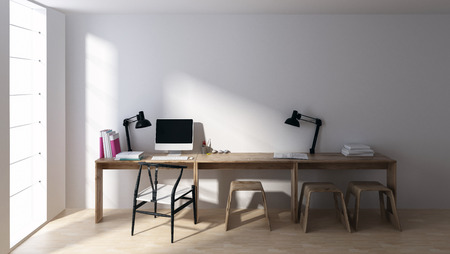 Computer and lamps at empty workstation in minimalist bright room with large windows