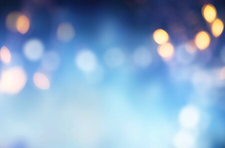 Bright blue background against defocused blurred lights