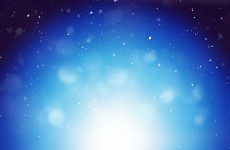 Magical winter blue background with blurred white lights and snowflakes floating against sky at night Stock Photo