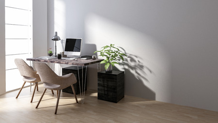 Chairs at desk with computer by empty workstation in bright room