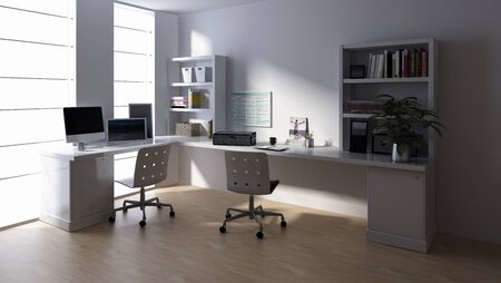 Desk with computer at empty workstation in bright office room