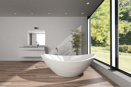 Modern spacious minimalist bathroom with a large boat shaped bathtub on a wood floor with vanity and mirror overlooking a large garden with trees. 3d render