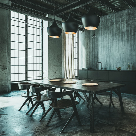 Modern industrial loft conversion dining area with contemporary table and chairs and a kitchen along a grunge grey wall behind lit by daylight from large windows. 3d render Standard-Bild