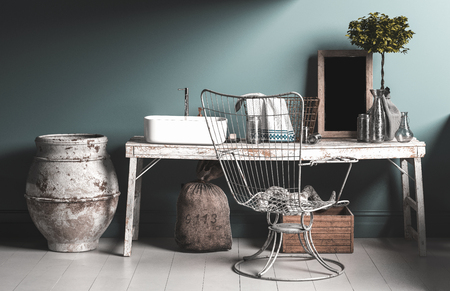 Old rustic vintage style bathroom interior with a wire work chair, grungy wooden table, old fashioned plumbing and ceramic urns on a tiled floor. 3d rendering Stock Photo