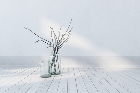 Minimalist fresh white room interior with wooden floor, skirting wall and twigs in a glass vase. 3d rendering.