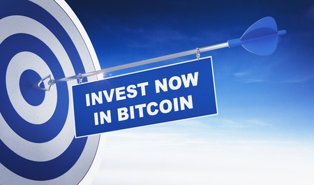 Blue arrow in the target with the sign Invest now in Bitcoin against blue sky with copy space. Cryptocurrency investment concept