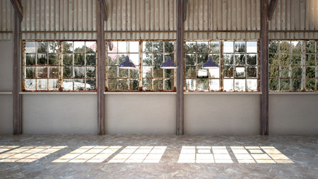 Empty interior of a brightly lit rustic industrial warehouse with rusty window frames, hanging lights and corrugated iron cladding.