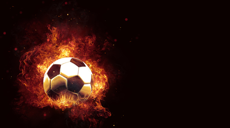 Fiery soccer ball engulfed in hot flames over a black background with copy space. 3d Rendering