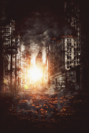 Fiery explosion in a city street between skyscrapers at night with burning debris littering the road and smoke in a dramatic conceptual image