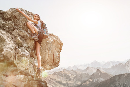 Bold and brave Girl doing Free Solo Rock Climbing