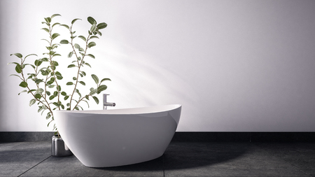 White contemporary tub standing close to leafy plant in metal pot standing on grey stone floor with white wall in background