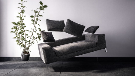 Fictional 3D image of rectangular black sofa with matching cushions and potted broad leaf plant floating in the air 写真素材