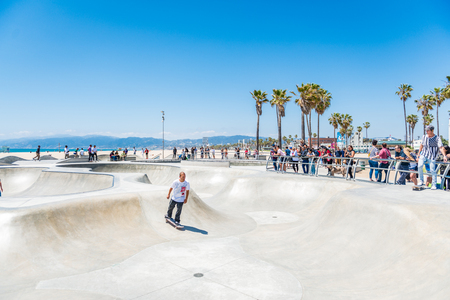 LOS ANGELES, USA - May 15 2018: High-angle full length view of a skater practicing skateboarding in a modern skate park in a sunny day of summer in Los Angeles, California, USA Editorial