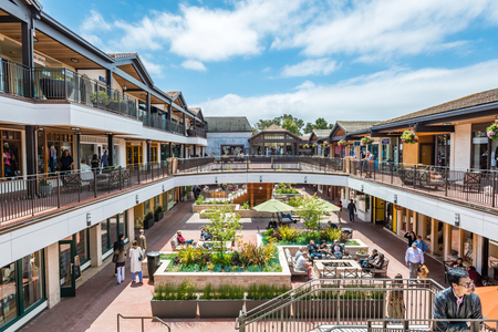 CARMEL-BY-THE-SEA, USA - May 13 2018: Shopping complex with outdoor central restaurant in Carmel-by-the-Sea, Monterey Peninsula, California a popular coastal tourist resort Editorial