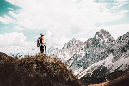 Female hiker on the top of mountain Stock Photo