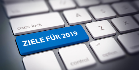 Ziele Fur 2019 concept with German text for the setting of business goals and targets for the New Year with text on a single blue key on a white computer keyboard