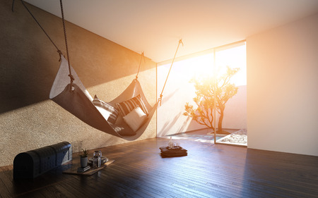 Hammock suspended from the ceiling in a contemporary minimalist living room with warm glow from the sun shining through glass window to an outdoor patio. 3d render