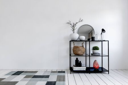 Multiple vases and potted plants on black metal display shelf next to rug on floor. Includes copy space. 3d rendering Banque d'images - 130167284
