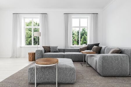 Comfortable minimalist sitting room interior with upholstered grey sofas and ottoman on a matching rug lit my two windows overlooking greenery. 3d rendering Banque d'images - 130167291
