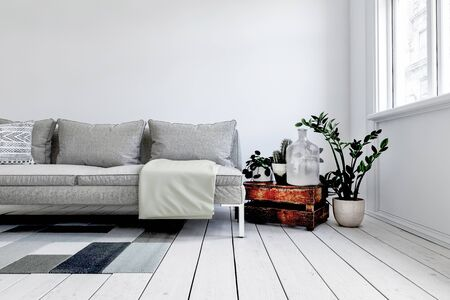 Digital render of modern grey couch in front of white wall next to rustic wood crate and small plant in pot. 3d rendering Banque d'images - 130167300
