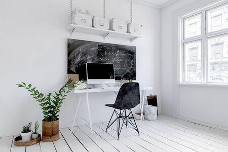 Trendy white office interior with blackboard above a small desk with computer and chair alongside potted plants. 3d rendering Banque d'images - 130167314