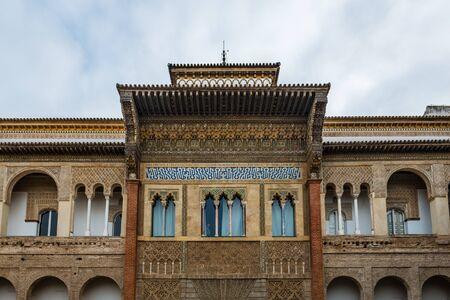 SEVILLE, SPAIN - December 09 2019: Exterior facade of the Patio de la Monteria courtyard in the Real Alcazar, Seville, Spain a Unesco listed World Heritage Site 新闻类图片