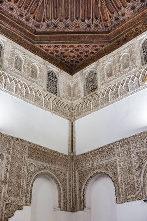 SEVILLE, SPAIN - December 09 2019: Detail of Moorish style ceiling and wall decoration with ornate intricate carving in the Real Alcazar, Seville, Spain 新闻类图片