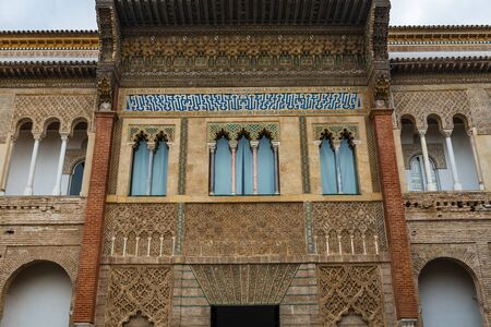 SEVILLE, SPAIN - December 09 2019: Detail of the exterior walls of Patio de la Monteria courtyard in the Real Alcazar, Seville Spain a Royal Residence and Unesco World Heritage Site