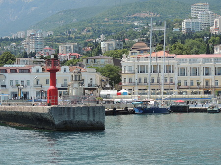 The embankment on the sea coast of the Black Sea and the mooring in the city of Yalta in the Crimea         photo