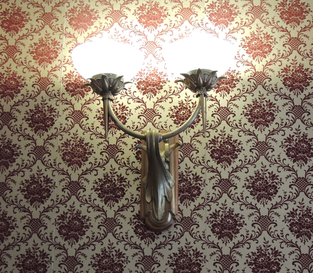 Vintage style. Vintage fixtures against the backdrop of the old classic wallpaper. Vintage Interior. photo