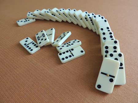 Domino effect.  The Falling Domino Principle. The game of dominoes. photo