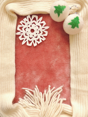 pink fur: Winter Christmas frame composition with pink fur and knitted scarf, with Christmas decorations. Stock Photo