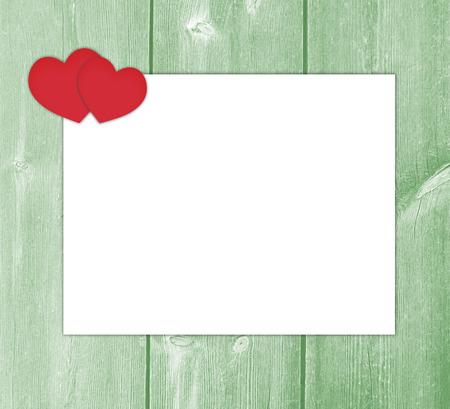 Love letter with hearts on green wooden background. Stock Photo