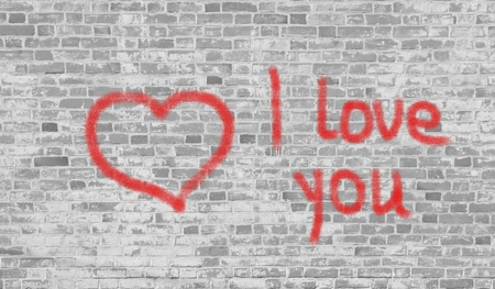 declaration of love: Drawn red heart and a Declaration of love to bright white brick background. Stock Photo