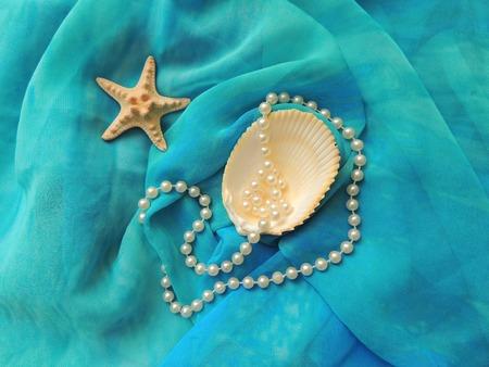 pareo: Marine composition on the textile turquoise pareo. Stock Photo