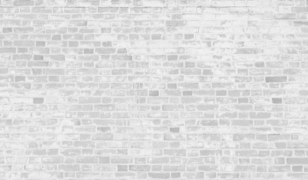 faded: Faded white brick wall background.