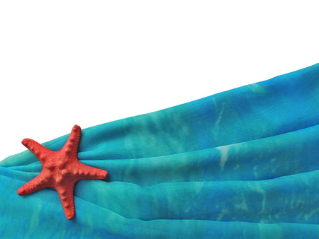 Turquoise folded pareo beach with a red starfish on white background, creative design template.