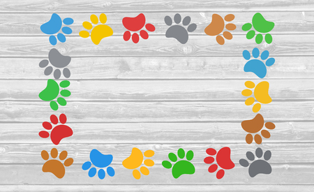 silueta de gato: Colorful paw prints animal frame on a wooden background with copy space for text. Foto de archivo